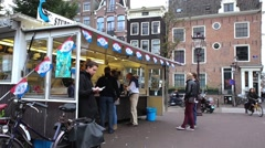 Famous local street vendor stubbe haring Stock Footage