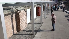 Tourists in Berlin visiting the Topography of Terror - stock footage