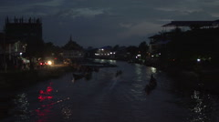 Nyaung Shwe, longboats floating in the harbour at night Stock Footage