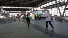 People walking inside a German railway station in Berlin Stock Footage