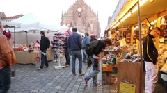 People visiting the Nuremberg market square Stock Footage