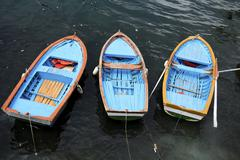 Three dory boats tethered in a row Stock Photos