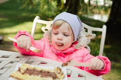 Child eating waffles with chocolate Stock Photos