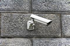 Security camera attached to the wall Stock Photos