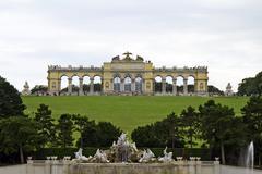 Gloriette structure and Neptune fountain in Schonbrunn Palace, Vienna, Austria Stock Photos