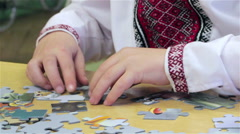 Boy is puzzles Stock Footage