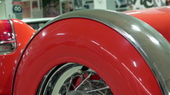 The rear of the car CADILLAC ELDORADO 1954 red convertible with a spare wheel - stock footage