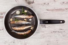 grilled anchovy fish on pan. - stock photo