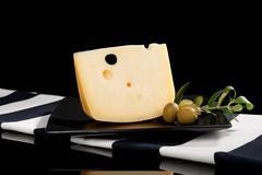 Emmental cheese still life. Stock Photos
