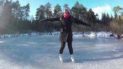 SLOW MOTION: Young woman spinning on ice skates Stock Footage