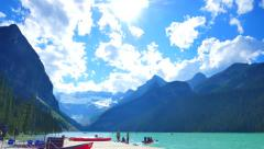 4K Lake Louise Canoes, Tilt Down Shot Ultra Wide Angle Stock Footage