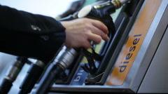 Gas Pump Nozzles Stock Footage