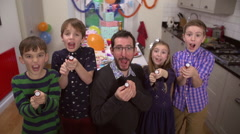 Happy family celebrating a birthday together in slow motion Stock Footage