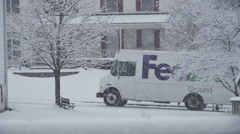 2884 FedEx Truck Driving in Snow During Storm in Slow Motion Stock Footage