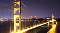Time Lapse of Star Trails over Golden Gate Bridge into Sunrise -Zoom Out- Stock Footage