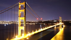 Time Lapse of Star Trails over Golden Gate Bridge into Sunrise -Close Up- Stock Footage
