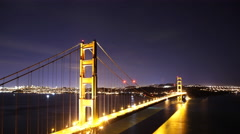4K Time Lapse of Star Trails over Golden Gate Bridge into Sunrise -Tilt Down- Stock Footage