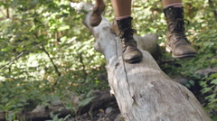 Stock Video Footage of Closeup Of A Couple's Feet, Walking On A Log, Toward Camera