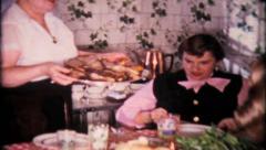 1626 - big family dinner, lots of food - vintage film home movie Stock Footage