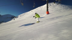 good skier skiing on ski piste in slow motion - stock footage