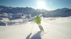 Stock Video Footage of sunshine skiing in austrian ski region slo mo