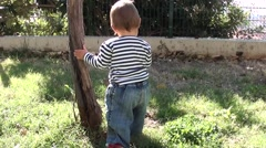 Baby in sailor vest and the tree Stock Footage