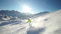 skiing off piste in slight moguls slo mo - stock footage