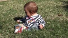 Baby in sailor vest on grass 2 Stock Footage