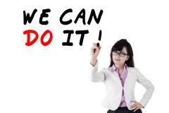 Female motivator writes advice words Stock Photos