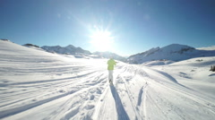 skier on connecting path to ski piste - stock footage