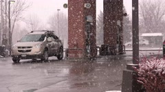 Snowing at Gas Station Stock Footage
