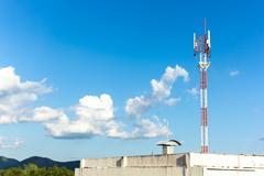 telephone mast on blue sky - stock photo