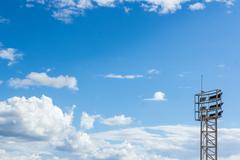 sportlight  mast on blue sky - stock photo