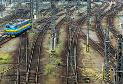 railroad tracks line crossing. train in motion top view - stock photo