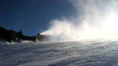 Snow making on slope. Mountain ski resort and winter calm mountain landscape. Stock Footage