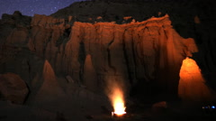 Astrophotography Time Lapse of Bonfire & Sandstone Formation at Dawn -Long Shot- Stock Footage