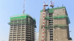 Construction building and crane movement time lapse Stock Footage