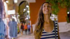 Beautiful Young Woman Female Walking Down Shopping Street Smiling Consumerism - stock footage