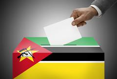 Stock Photo of ballot box painted into national flag colors - mozambique