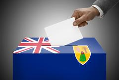 ballot box painted into national flag colors - turks and caicos islands - stock photo