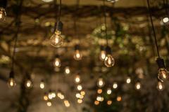 Lighting decor. Retro light bulb filament close up.Illuminated. Stock Photos