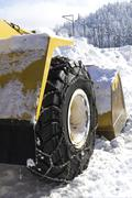 Wheel loader machine removing snow in winter on the road - stock photo