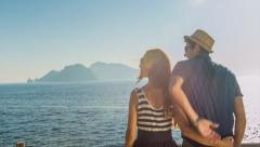 Beautiful Young Romantic Couple On Vacation Hugging Cissing Beach Island View Stock Footage