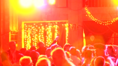 People dancing in spot light rays lumiere on a disco - stock footage
