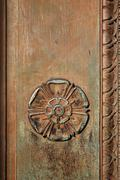 carved tudor rose on a vintage doorway - stock photo