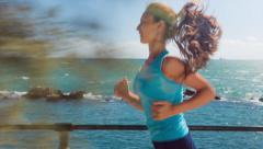 Beautiful Young Active Attractive Female Running Coastline Jogging Healthy Stock Footage