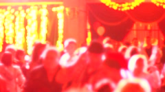 People dancing in spot light rays lumiere on a disco Stock Footage