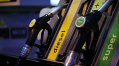 Gas pump nozzle at night Stock Footage