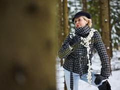 fashionable woman and winter clothes - rural scene - stock photo