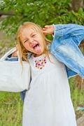 Girl makes faces imitate witch Stock Photos